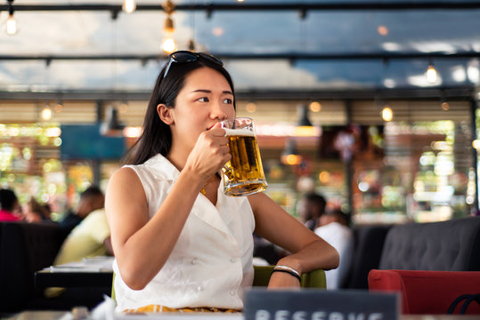 Girl having a beer in the bar