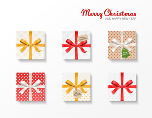 Square gift box set. Gold, red, silver color bow knot, ribbons, kraft ball and tree hang tags. Snowflake pattern paper. Merry Christmas text. Happy New Year package. Vector illustration 3d top view