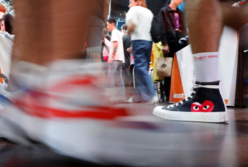 A man walks wearing a limited edition of Converse Chuck Taylor All Star Õ70  sneakers at 22070d5ae