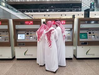 Saudi people buy tickets for the new Haramain speed train at King Abdullah Economic City, near Jeddah