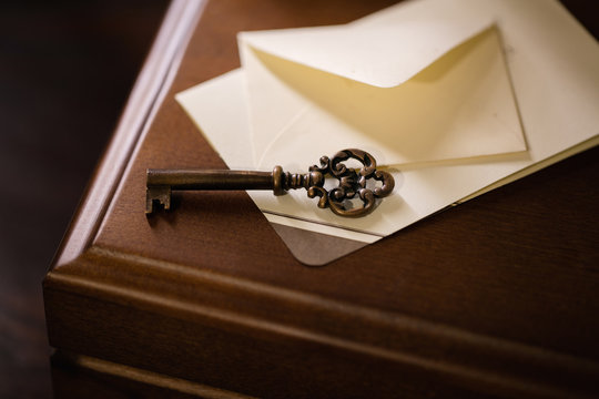 Key on the box from letters | a box with secret letters, an old copper key, a repository for a family archive.