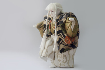 Clay doll of japan of Hakata-ningyoo in Black and Gold color uniform.