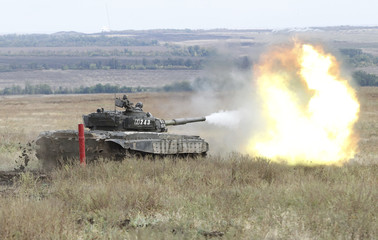 A T-72B tank, operated by servicemen of the self-proclaimed Lugansk People's Republic, fires during military exercises at a target range in Luhansk Region