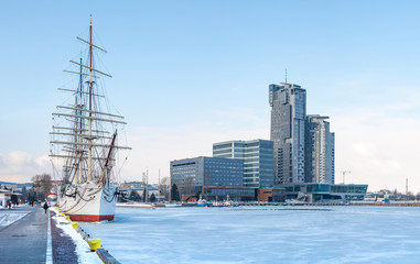 Old ship on frozen sea and busyness building