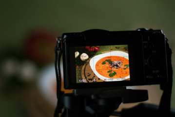 Backstage of shooting vegetable soup in a restaurant.
