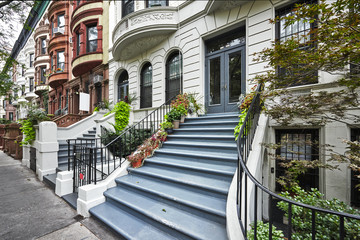 a row of colorful brownstone buildings in Manhattan New York