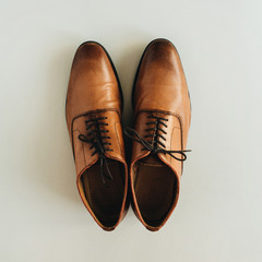 Men's leather shoes on pastel background. Flat lay, top view.