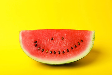 Watermelon with funny smiling face on color background