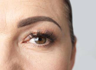 Beautiful older woman, closeup of eye