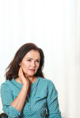 Portrait of beautiful older woman against light background