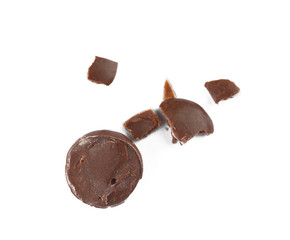 Crushed chocolate candy on white background, top view