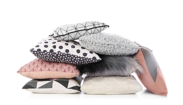 Pile of different colorful pillows on white background