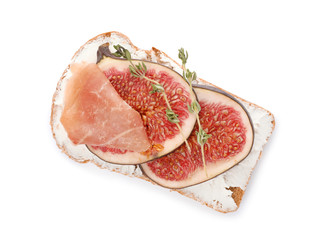 Sandwich with ripe fig, prosciutto and cream cheese on white background, top view
