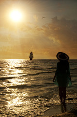 silhouette of girl on the beach at sunset