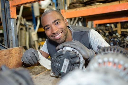auto mechanic in garage warehouse
