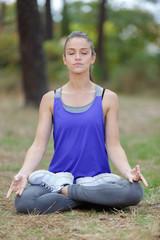 woman doing a lotus yoga posture