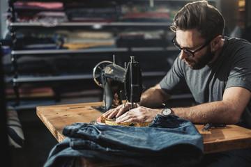 Fashion designer working in his studio Wall mural