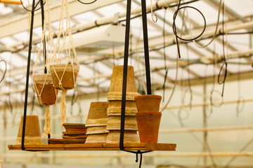 Ceramic pots on shelf hung from ceiling