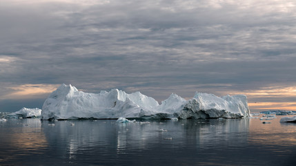Iceberg at sunset. Nature and landscapes of Greenland. Disko bay. West Greenland.