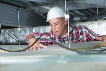 male construction worker in the ceiling