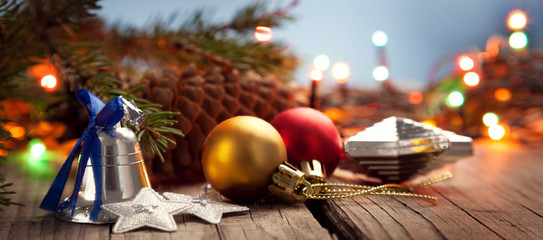 Christmas ornaments on a wood table with a nice festive background Xmas illuminations