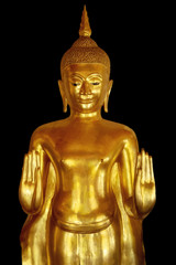 Golden buddha isolated on the black background