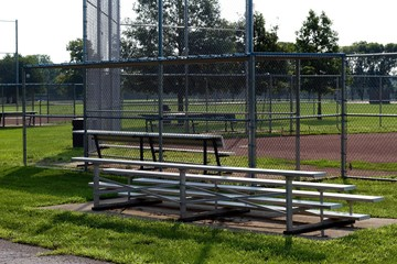 The bleachers behind home plate at the ball field.