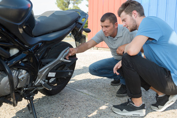 young man checking out a motorbik