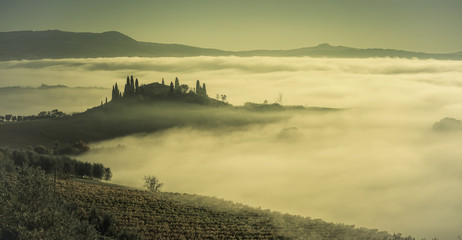 Autumn fog in valley with hills