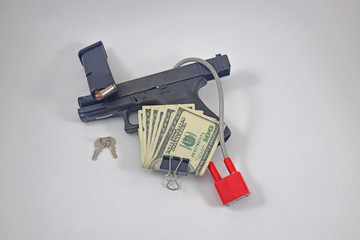 Gun with lock, cash, ammunition
