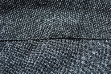 warm jacket sleeve wool fabric texture background close-up.