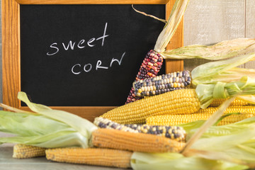 Cheerful and Colorful dried Indian Corn with black desk as decoration