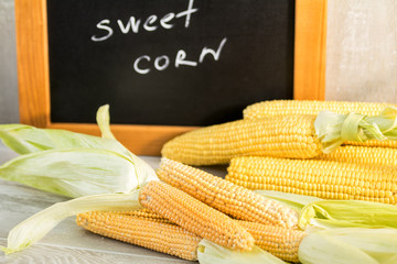 Sweet Corn with black desk as decoration for Thanksgiving Table, Halloween, and the Fall Season