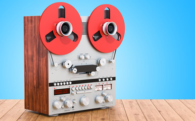 Retro reel-to-reel tape recorder on the wooden table. 3D rendering