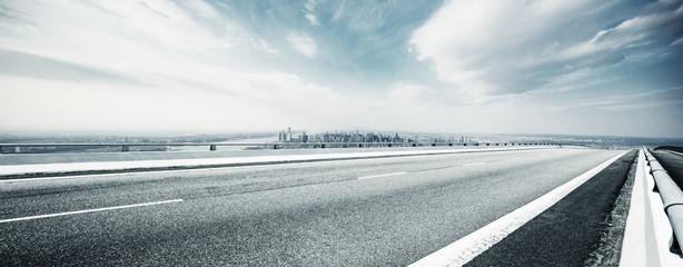 Fototapete - empty highway through modern city