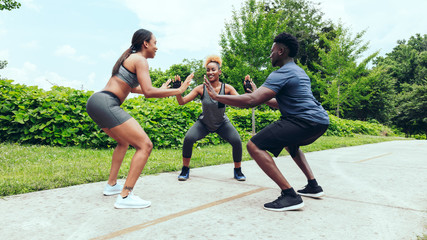 Man and women exercising in park