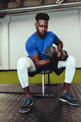 Man working out with dumbbell in gym