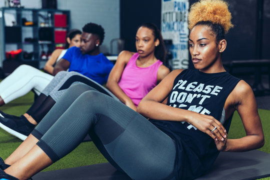Man and women working out in gym