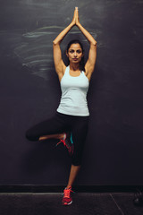 Portrait of woman practicing yoga in gym