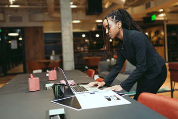 Young woman working in creative office
