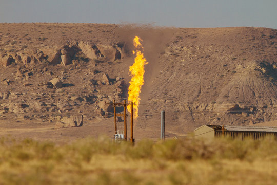 Methane burning at a flare stack in rural America adds a harmful greenhouse gas to the atmosphere