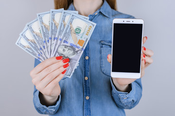 Loan touchscreen screen interface touch people person gift fan bill jeans shirt store win transaction transfer  usa buy customer concept. Close up portrait of lady with cash isolated background