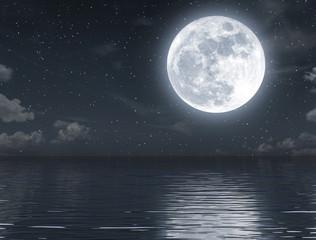 Full moon rising and empty ocean at night