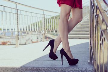 Profile side turned half photo view close up portrait of stylish beautiful charming attractive sexual seductive affectionate long nice legs with smooth flawless skin. Nature town urban center concept