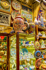 Among countless shops in Grand Bazaar market in Istanbul. Shopping and travel in Turkey concept