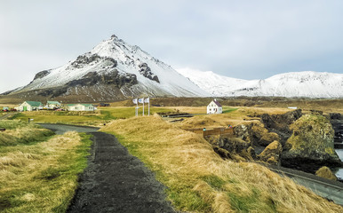 Snæfellsnes Peninsula Fishing Village and mountains with snow at western Iceland