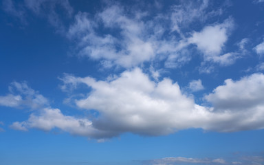 Blue sky with summer cumulus clouds
