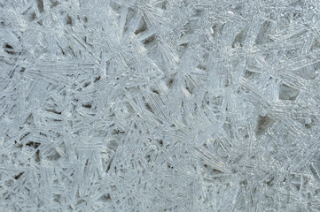 Rime, frost, ice texture. ice pattern texture. Ice on the winter lake. Closeup.