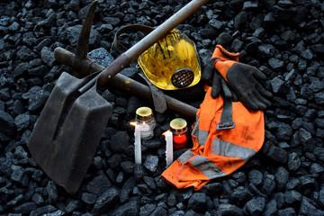 Vigil light, candle with the miner belongings (helmet, gloves, pickaxe, shovel, vest, belt)