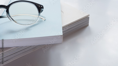 Wall mural Close up with glasses and book